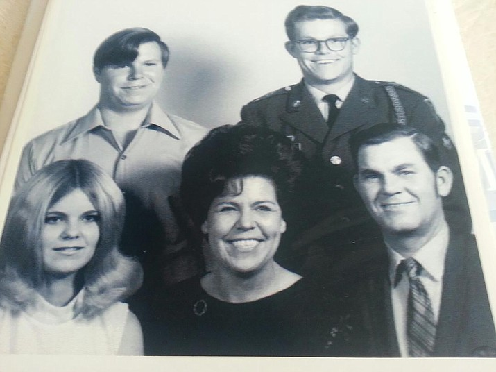Don Martin stands with his family shortly after he enlisted in the Army in 1969.