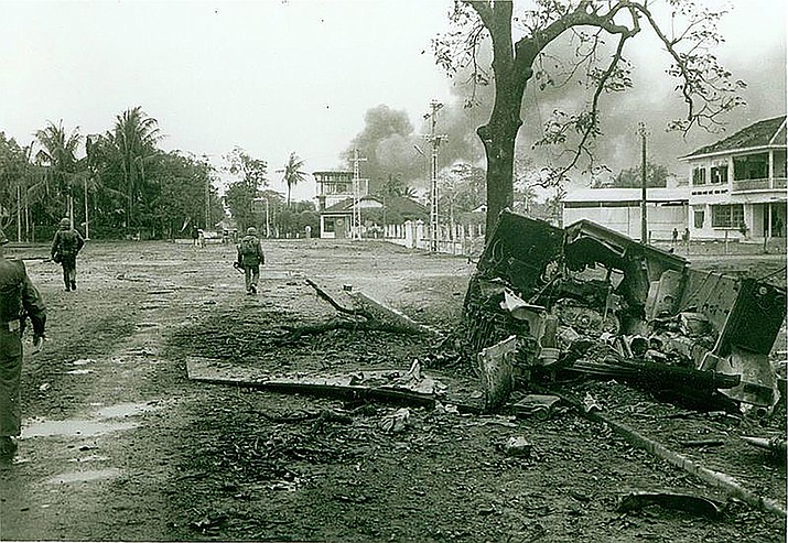 Marines move cautiously through the streets of Hue as they mop up the remaining pockets of enemy resistance near the end of the 25-day battle.