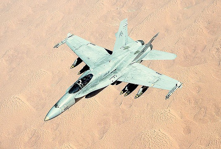 A military jet flies over Iraq in the first Gulf War.