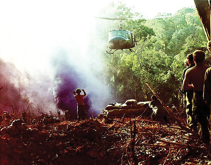 A soldier directs a chopper pilot in the Central Highlands of Vietnam in 1969.