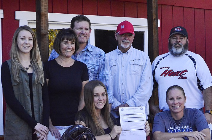 Morgan Mabery (bottom left) poses with her new college coach, her parents, sister, grandfather and club coach during her signing with South Mountain Community College Friday at the Blazin' M Ranch. (VVN/ JT Keith)