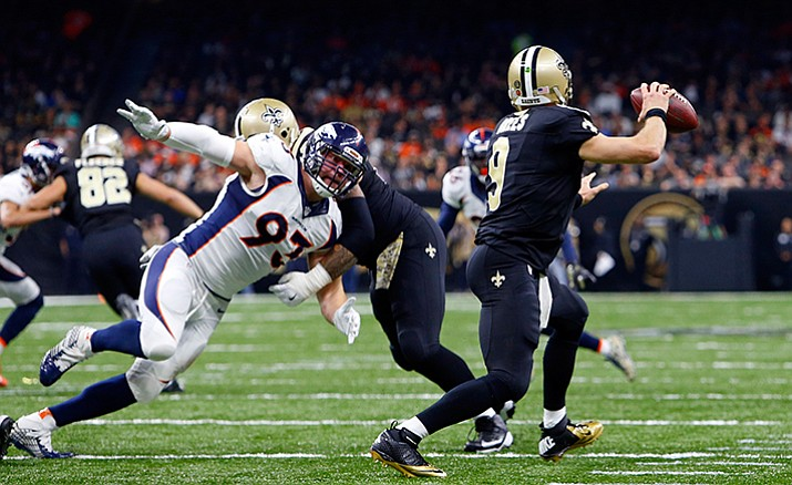 New Orleans Saints quarterback Drew Brees scrambles under pressure from Denver Broncos defensive end Jared Crick (93) in the second half of an NFL football game in New Orleans, Sunday, Nov. 13.