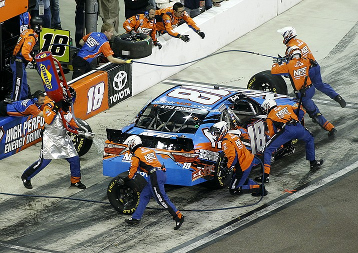 Kyle Busch makes a pit stop during a NASCAR Xfinity Series auto race at Phoenix International Raceway, Saturday, Nov. 12, in Avondale.