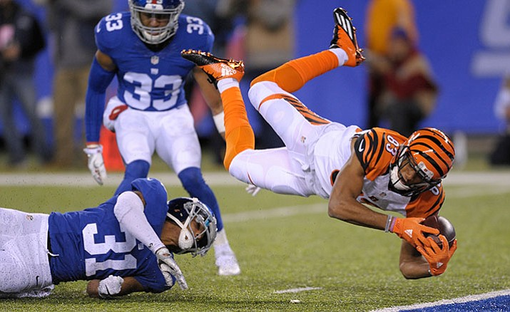 Cincinnati Bengals wide receiver Tyler Boyd is upended by New York Giants cornerback Trevin Wade during the third quarter of an NFL football game, Monday, Nov. 14, in East Rutherford, N.J.
