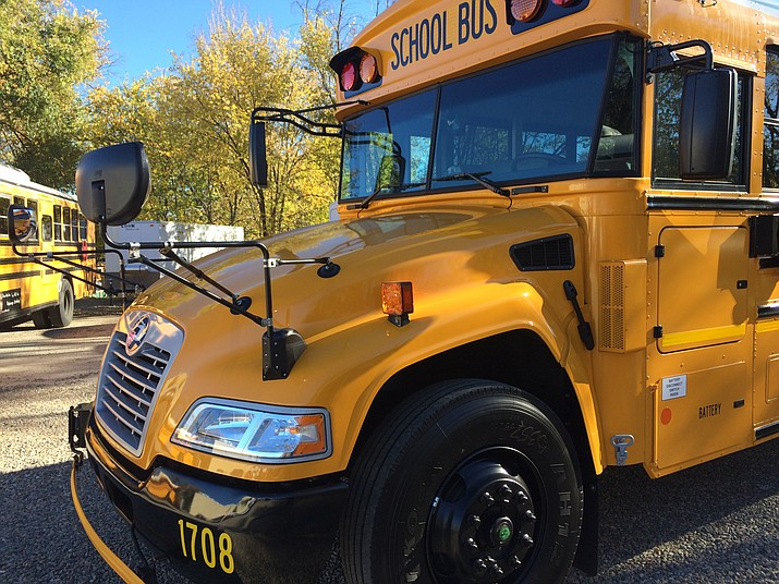 One of Prescott Unified School District's new buses, with its hooded rather than flat front, sits ready for students.
