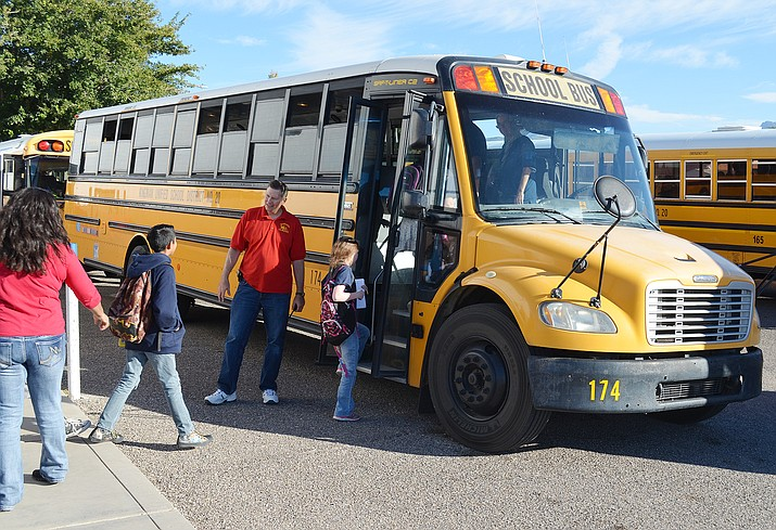 Manzanita Elementary School Principal Scott Taylor guides students onto their assigned buses.