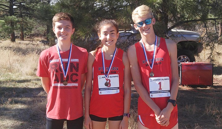 Allyson Arellano (center) won her fourth consecutive Arizona Junior Olympic Cross Country individual state championship Saturday in the girls 17-18 division. Aftershock teammates Josh Reilly and Trenton Stafford came away with top 10 finishes in the 15-16 boys division. (Photos courtesy of Micah Swenson)