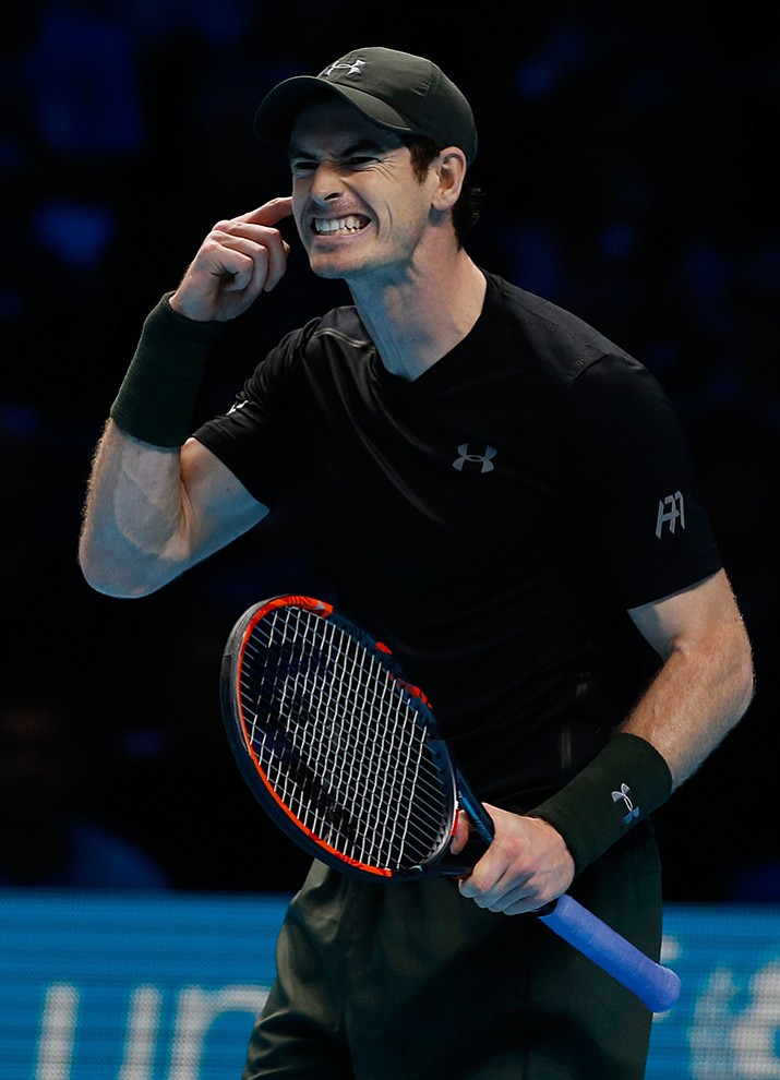 Britain's Andy Murray gestures after playing a point to Kei Nishikori of Japan during the ATP World Tour Finals singles tennis match at the O2 arena in London, Wednesday, Nov. 16.
