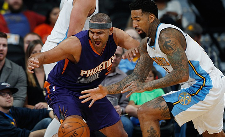 Phoenix Suns forward Jared Dudley, left, battles for control of a loose ball with Denver Nuggets forward Wilson Chandler in the first half of an NBA basketball game, Wednesday, Nov. 16, in Denver.