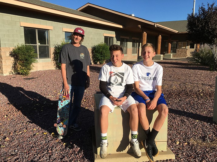 (From left) Isaac Alana, James Long and Kohl Hill relax in front of the Chino Valley Community Center. The town is considering leasing a portion of the building to the Central Arizona Boys and Girls Club to run a program just for teens.
