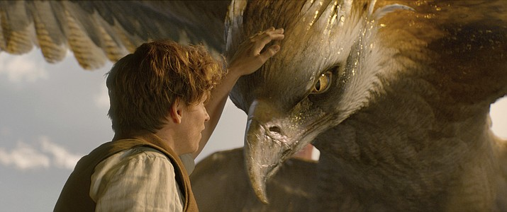 "This image released by Warner Bros. Entertainment shows Eddie Redmayne in a scene from ""Fantastic Beasts and Where to Find Them."""