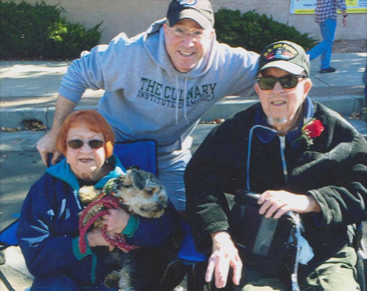 Attending the 2016 Veterans Day Parade in Prescott, standing, son Mark Quitney of New Orleans, in the chair, Lester Quitney, U.S. Air Force veteran and at his side is wife Nancy and their Yorkiepoo, Charlie.