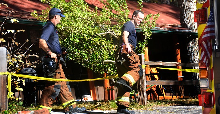 Sedona Fire District firefighters are seen at the scene of a LP gas explosion in Oak Creen Canyon on Friday morning. VVN/Vyto Starinskas