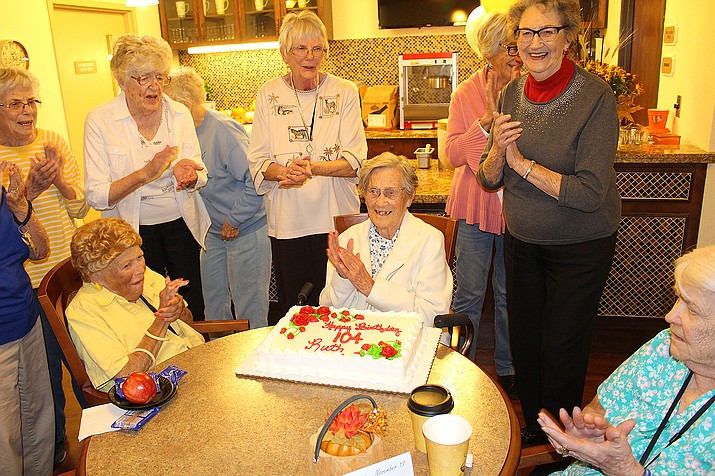 Ruth Sorensen, seated in the middle, celebrates her 104th birthday Thursday with other residents at White Cliffs Senior Living in Kingman.