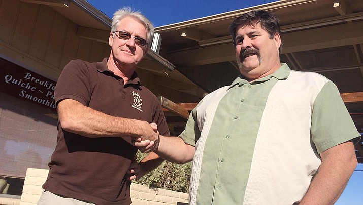 On Nov. 21, Thanks a Latte owner Paul Hawk, left, will hand over his Camp Verde business to Darryl Olinick. As the shop's new owner, Olinick says he would like to add roasted and candied nuts to the menu, as well as cold brewed coffee. Other than that, Olinick says he won't change the menu that Thanks a Latte patrons have grown accustomed to ordering from. (Photo by Bill Helm)