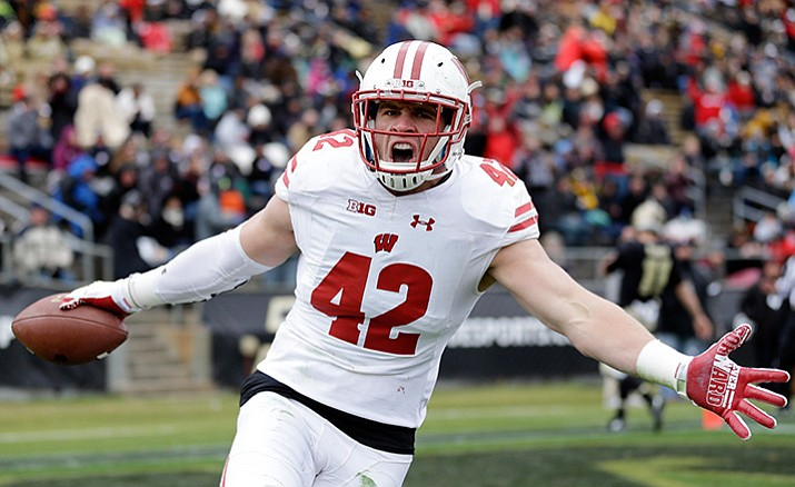 Wisconsin linebacker T.J. Watt (42) celebrates after returning an interception for a touchdown during the first half of an NCAA college football game against the Purdue in West Lafayette, Ind., Saturday, Nov. 19.