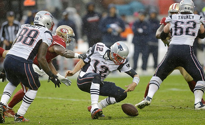 New England Patriots quarterback Tom Brady (12) loses the ball as he his hit by San Francisco 49ers linebacker Ahmad Brooks, left, during the second half of an NFL football game in Santa Clara, Calif., Sunday, Nov. 20. Brady recovered the ball.