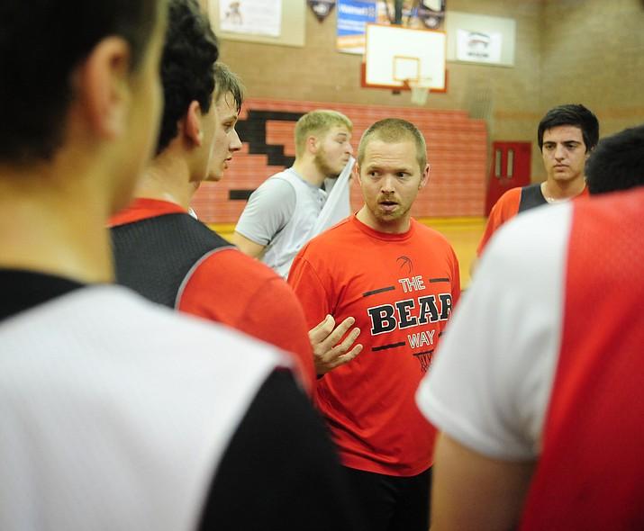 Bradshaw Mountain head coach Matt Simpson, center, talks to his players during practice Nov. 16 in Prescott Valley.