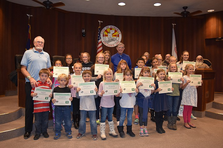 "Kingman Mayor Richard Anderson in the Center, with Kingman Clean City Commissioner Clarence ""C"" Russell with the 2016 students winners of the American Recycles Day Poster and Essay Contest at Kingman Council Chambers on Thursday. From the left is Cody Bush, Jorden Murphy, Trenten Sommers, Holly Kennedy, Kaydence Douglass, Daylee Brazdys, Isabel Lopez, Elise Alleman, Mackenzie Hecht, Anika Batiste, Natashia Ziegenmeyer, Sophia Meredith, Cherokee Holguin, Robert Brackett, Isabella Frisby, Kaden Lewis, Lanie Dela Pena, Brooke Forsse, Aspen Martinez, Amelia Brackett, Breann Latimer, and Brianna Oktay."