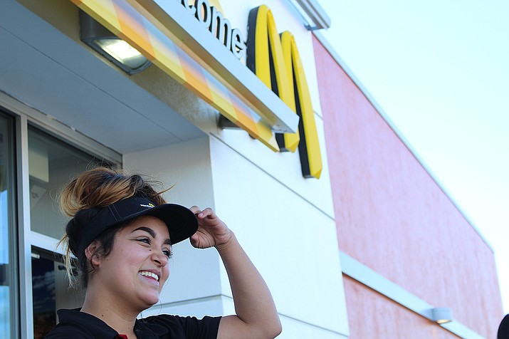 McDonald's employee Gabby Saenz said she gets a good vibe working with her crew, but isn't sure about the benefits of a minimum wage increase.