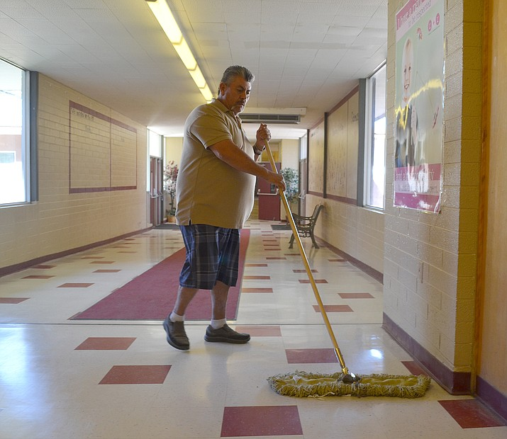 Ernie Tapia, lead custodian at Manzanita Elementary School, has concerns employee morale might be damaged when the minimum wage hike takes effect Jan. 1.