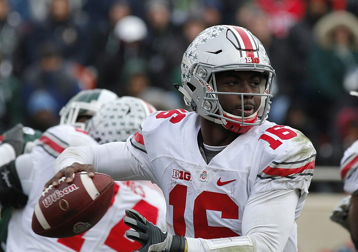 Ohio State quarterback J.T. Barrett looks to throw against Michigan State during the fourth quarter Saturday in East Lansing, Mich. Ohio State won 17-16.