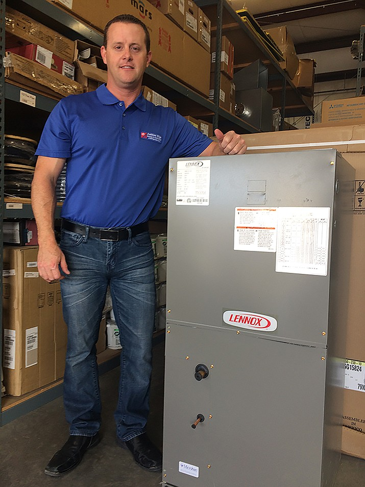 Steve Lewis, president and owner of Ambient Edge, shows one of the Lennox heating and air conditioning units in his shop. Ambient Edge is a leader in HVAC replacements in Mohave County, based on weekly building permits issued.