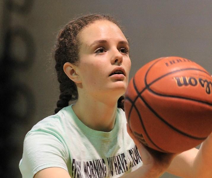 Freshman Alaina Karlsberger practices free throws.