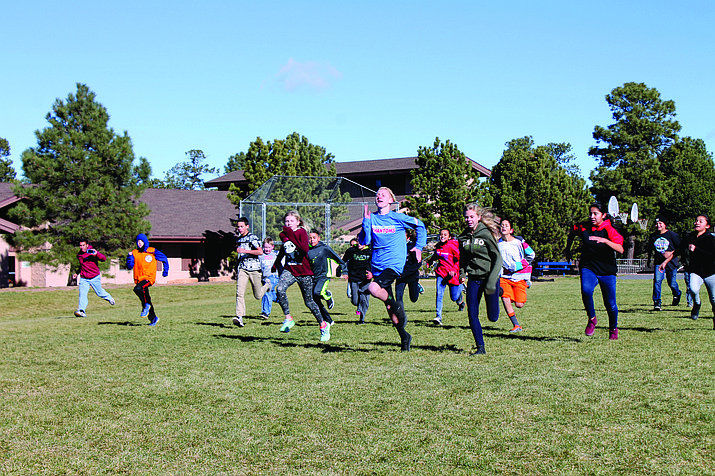 Middle school students get off to a fast start for their 1-mile Turkey Trot; Roman Evans leads the pack.