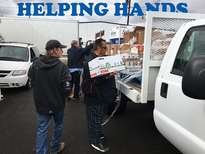 Volunteers at Cornerstone Mission unload a truck of food donated by Aquarius Casino Resort on Monday. The mission expects to feed more than 100 people through the soup kitchen on Thanksgiving.