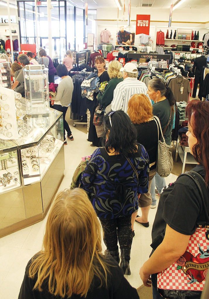 Kingman won't see the frenzied crowds the big cities do on Black Friday,  above, but that doesn't mean great deals aren't available. Just ask these shoppers at JC Penney in Kingman, right, who kept staff at the store extremely busy during Black Friday 2015, as this photo by Miner photographer JC Amberlyn illustrates.