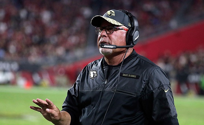 Arizona Cardinals head coach Bruce Arians coaches against the San Francisco 49ers on Nov. 13 in Glendale. Arians was in the hospital Monday after feeling ill returning home from the Minnesota Vikings game, but was back at practice Wednesday.