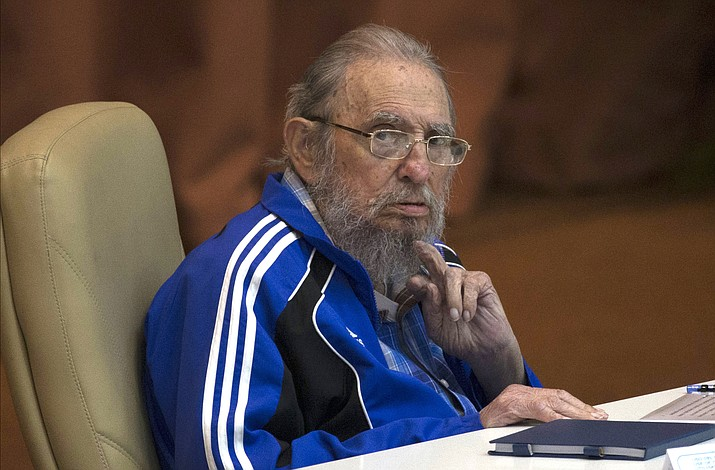 In this April 19, 2016 file photo, Fidel Castro attends the last day of the 7th Cuban Communist Party Congress in Havana, Cuba. Fidel Castro formally stepped down in 2008 after suffering gastrointestinal ailments and public appearances have been increasingly unusual in recent years. Cuban President Raul Castro has announced the death of his brother Fidel Castro at age 90 on Cuban state media on Friday, Nov. 25, 2016.