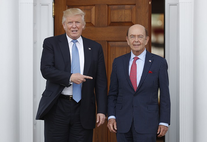 In this Sunday, Nov. 20, 2016, file photo, President-elect Donald Trump, left, stands with investor Wilbur Ross after meeting at the Trump National Golf Club Bedminster clubhouse in Bedminster, N.J. Trump is poised to offer the position of commerce secretary to the head of a private-equity firm, Wilbur Ross.