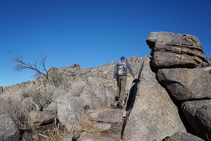 Glenn Schlottman, public information officer and chief of marketing for Arizona State Parks, walks along a portion of the Hotshots Trail in the new Granite Mountain Hotshots Memorial State Park in Yarnell. The trail rises steeply for about 2.85 miles before reaching a plateau where an observation deck has been built.