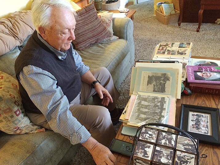 Dave Lange at his Prescott home with his scrapbooks and family photos.