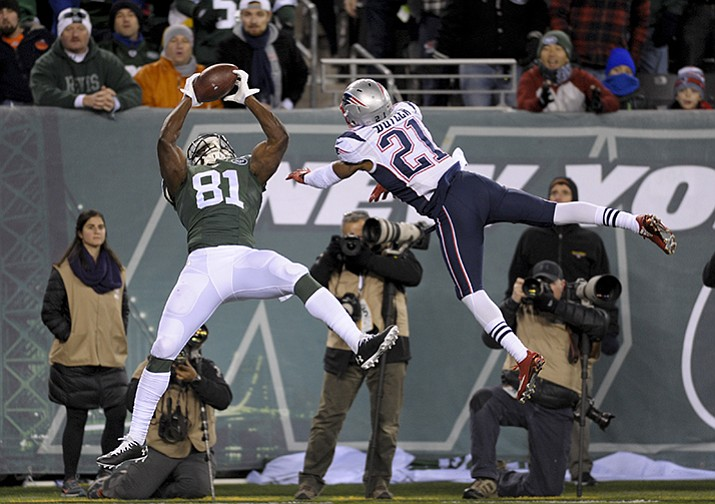 New York Jets wide receiver Quincy Enunwa makes a touchdown catch against New England Patriots cornerback Malcolm Butler during the fourth quarter of an NFL football game, Sunday, Nov. 27, in East Rutherford, N.J.
