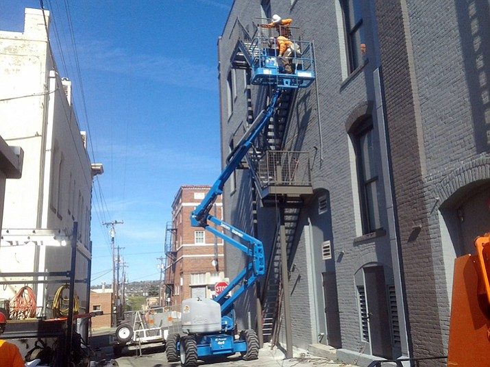 Crews with The Ironworker, Inc. work to install a new fire escape on the exterior of the Elks Theatre in early November. The new staircase was the final component on the renovations that have been going on at the historic Elks building for the past several years.