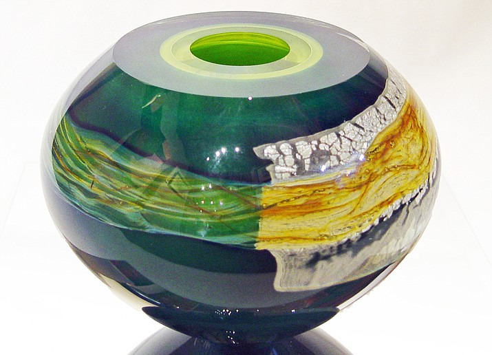 """Mykannos,"" by Randi Solin, is a hand-blown studio glass vessel that measures 7""h x 8""w x 8""d. It will be featured in the new ""Holiday Gift Show"" opening at Lanning Gallery in Sedona, with a 1st Friday reception, December 2nd from 5-8 pm."