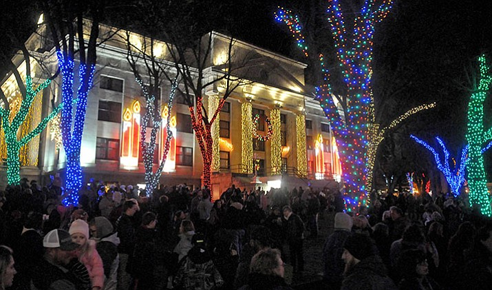 Related Christmas lights and crowds in Prescott, AZ courthouse square.image