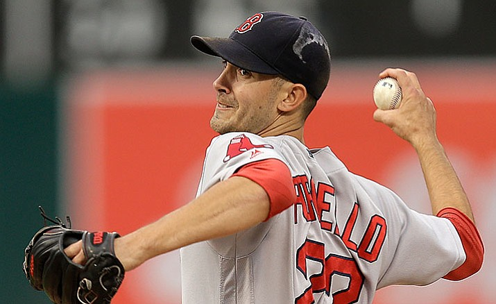 In this Sept. 3, 2016, file photo, Boston Red Sox pitcher Rick Porcello works against the Oakland Athletics in the first inning of a baseball game, in Oakland, Calif. Boston Red Sox pitcher Rick Porcello has won the AL Comeback Player of the Year award, while Washington Nationals third baseman Anthony Rendon received the NL honor, Tuesday, Nov. 29.