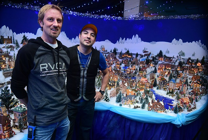 Matt Brassard and Marco Espitia are the brains and brawn behind The Enchanted Christmas Tour of Lights that opened November 25 and runs through December 30, 2016 at the Prescott Gateway Mall.(Les Stukenberg/The Daily Courier)