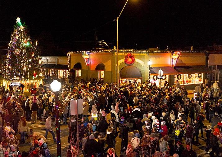 A crowd gathers after the Parade of Lights for the lighting of the Christmas tree in downtown Williams.