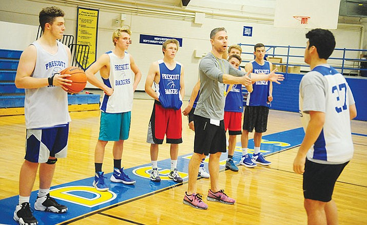 Prescott Head Coach Adam Neely coaches a drill during practice Thursday.