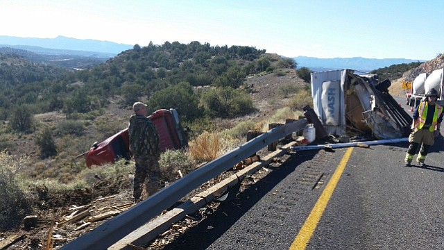 According to Eric Strauss, battalion chief for Copper Canyon Fire & Medical Authority, emergency crews arrived to find a full-size pickup truck pulling a large RV trailer had rolled over. The truck had separated from the trailer and rolled over the guardrail, approximately 15 to 20 feet down the embankment.  (Courtesy photo, Copper Canyon Fire & Medical Authority)
