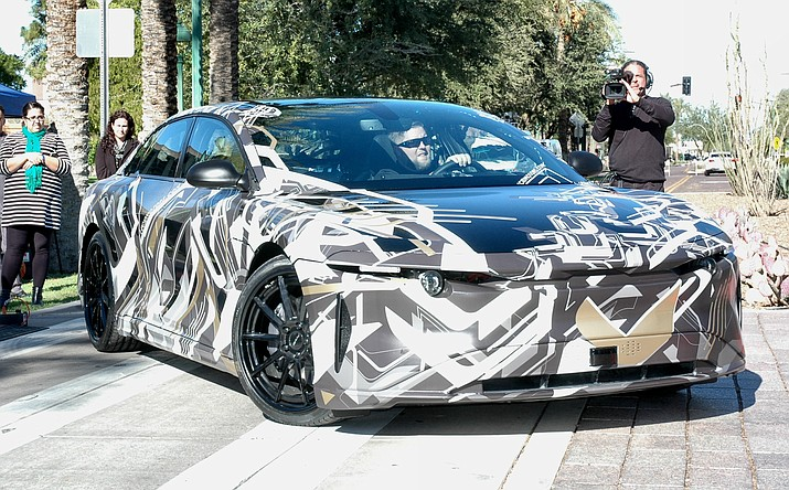 This is the prototype of what Lucid Motors says will become its $100,000-plus all-electric vehicle to be manufactured in Casa Grande. The unusual stripes are a form of camouflage to keep it from being recognized and copied by other car companies. (Capitol Media Services photo by Howard Fischer)