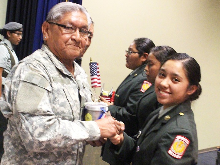 "Cadet Jasmine ""Jazzie"" Perez honors Eugene Secakuku. Photo/Stan Bindell"
