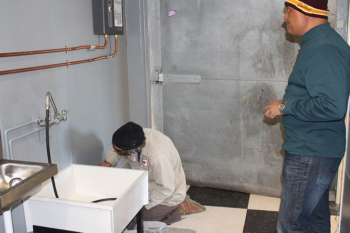 Willie Walker of Truelove Plumbing works on a sink at Gas Plus, which has been under renovation at 2266 Kingman Ave. Owner Sam Patel said the convenience store and gas station should be open by Dec. 15.