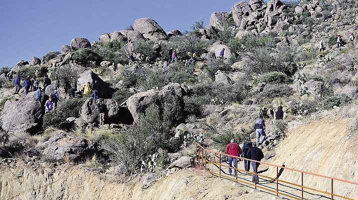Hikers ascend the newly dedicated Hotshots Trail in the new Granite Mountain Hotshots Memorial State Park, which features a plaque for each of the 19 men who perished fighting the Yarnell Hill Fire in 2013.