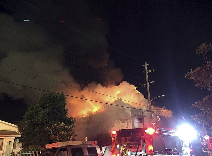 This photo provided by @seungylee14 shows the scene of a fire in Oakland, early Saturday, Dec. 3, 2016. The blaze began at about 11:30 p.m. on Friday during a party at a warehouse in the San Francisco Bay Area city. Several people were unaccounted for.